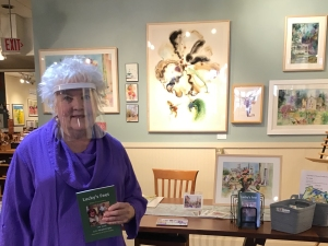 Artist Jo Myers-Walker in front of a display of her paintings inside Iowa Artisans Gallery, November 2020
