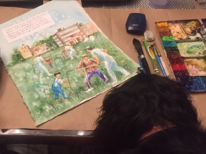 A small dog inspects a watercolor illustration by artist Jo Myers-Walker